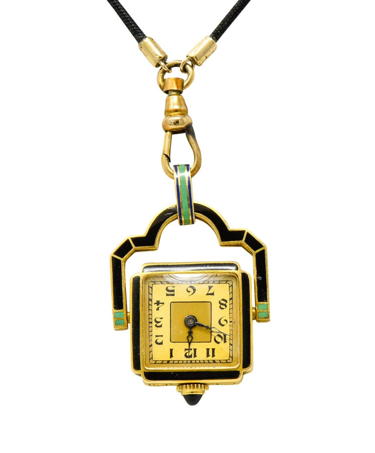 Centering a cushioned square pendant rotating within an arched frame  Frontside of pendant and frame are colorfully enameled red, blue, black, and green  Backside of pendant depicts and antique watch with an onyx cabochon crown  Profile features a