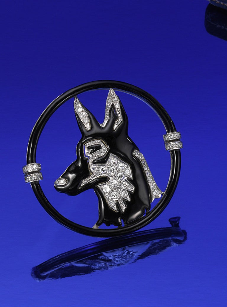 Platinum large and 18K yellow gold, Art Deco brooch  in black enamel with diamond by Black, Starr & Frost, circa 1925.  The German Shepard is well done with fine white diamonds all near colorless (H) and very very slightly included.  Large and