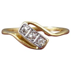Art Deco Engagement Ring Set with Three Diamonds in Rectangular Cross over Twist
