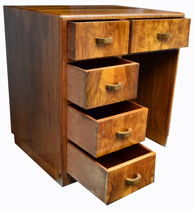 For your consideration is this lovely and totally original walnut desk dating from the 1930s. Compact in size this little desk is perfect if the space available is limited and of consideration. Generally sized top which is plentiful space for desk