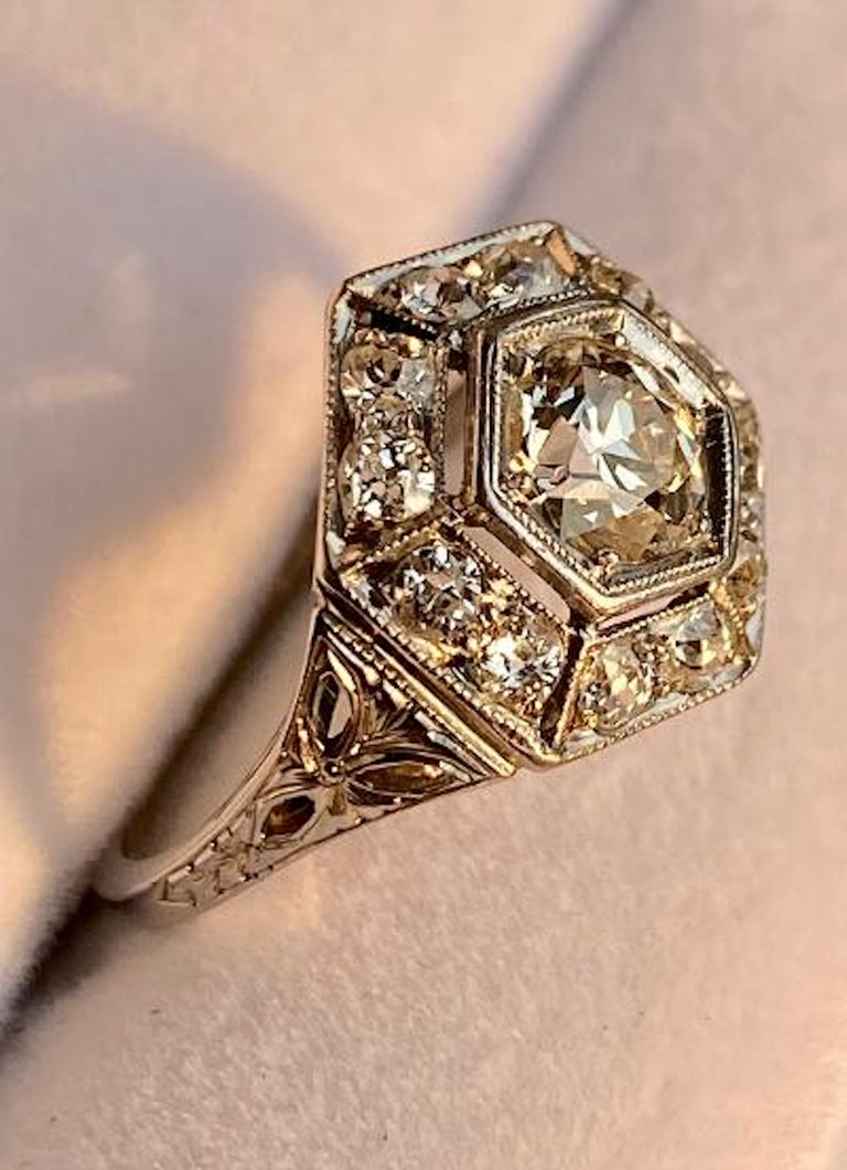 Very elegant, hand made, ladies vintage Art Deco era diamond ring featuring a custom made hexagon design platinum mounting having the total combined weight of approximately 2.20 carats.  The center stone is an approximately 1.00 carat Old European