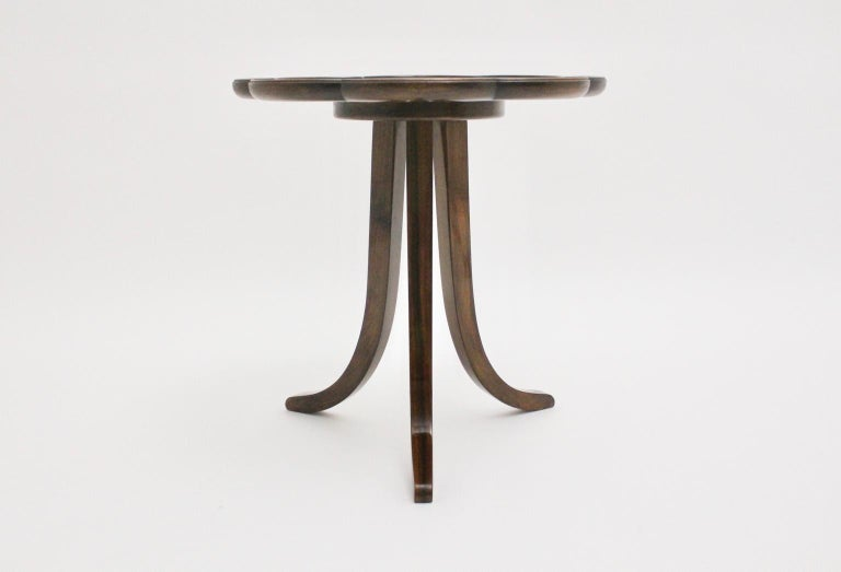 This presented round and trilegged side table was designed by the very popular Viennese designer Josef Frank circa 1925, Austria. The designer Josef Frank stands for a great design philosophy. Also the side table was made of veneered walnut.