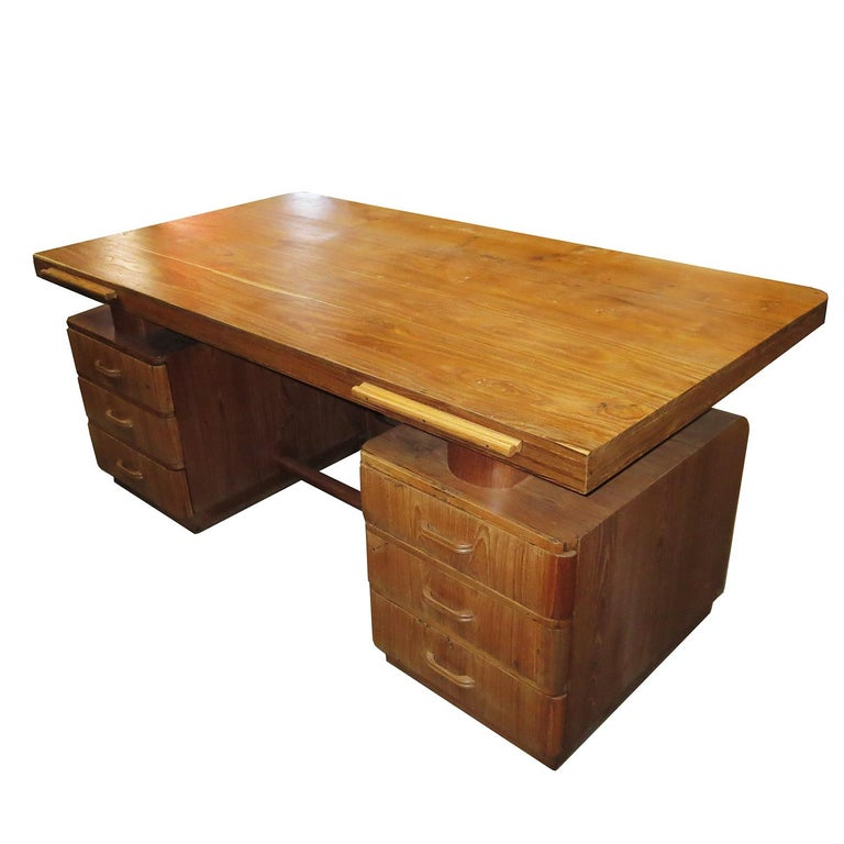 This stylized desk features curved corners and a unique grille in the front center. The expansive top surface seems to float over the top. There are three drawers and pullout / pull-out writing surfaces on each side, for ample storage and