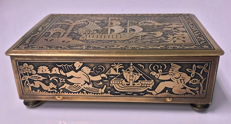 Art Deco brass Jewelry box, Germany, circa 1920 possibly by Erhard & Söhne of Schwäbisch Gmünd. The box of rectangular shape on brass bun feet, the brass body and cover oxidized inlay decorated with various scenes of running figures, animals, sunset