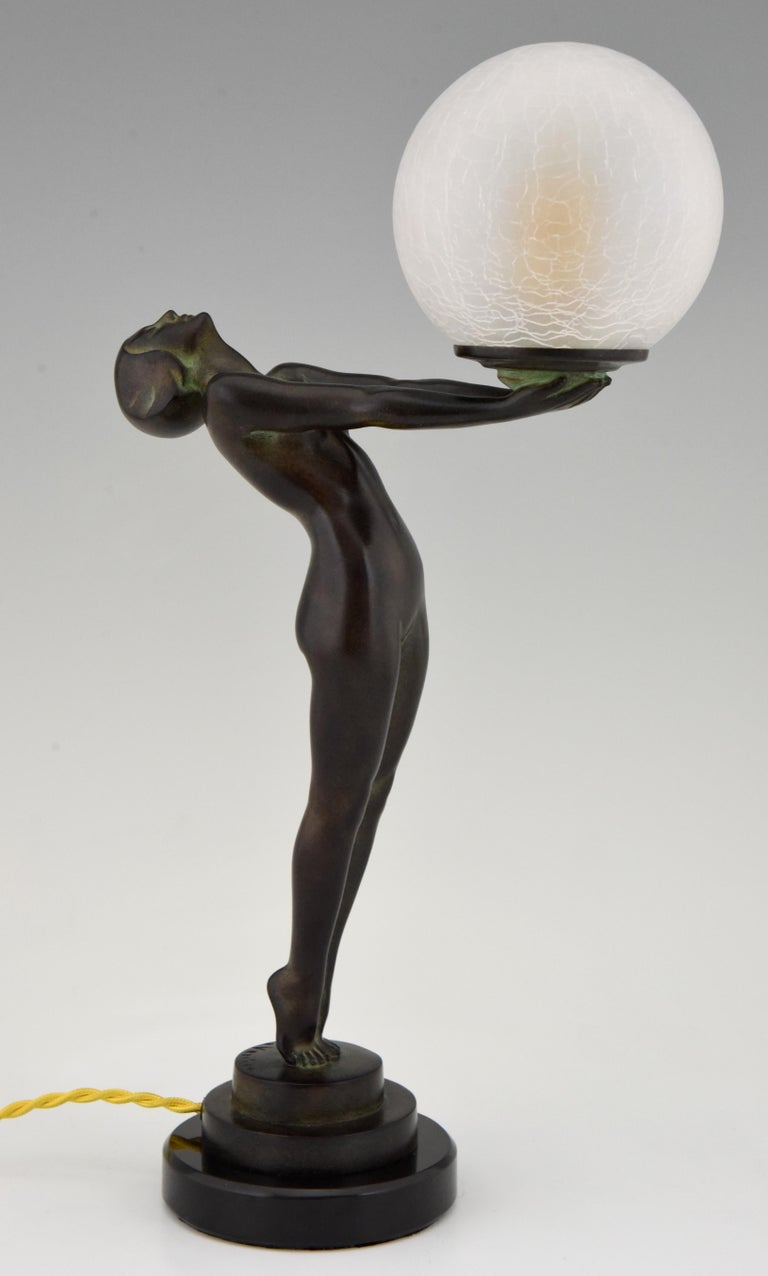 Contemporary Art Deco Figural Lamp Standing Nude Holding a Glass Shade Max Le Verrier Clarté For Sale