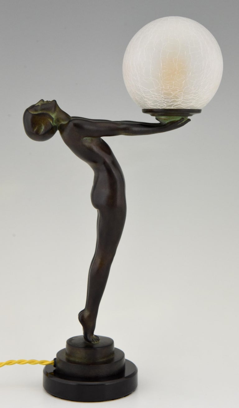 Metal Art Deco Figural Lamp Standing Nude Holding a Glass Shade Max Le Verrier Clarté For Sale