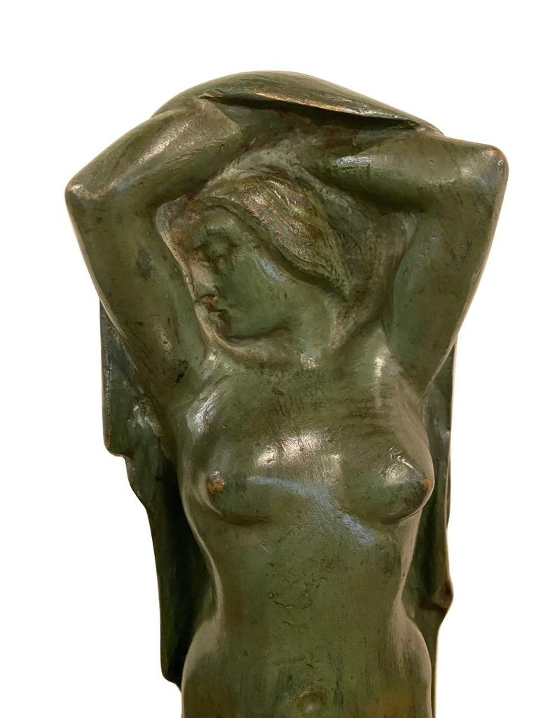 Figurative Art Deco sculpture of standing woman in bronze on marble. Important Belgian sculpture with great history and background. Unique piece in verdigris on bronze stylized Art Deco era circa 1930s. The woman is draped in a cape or shawl in a