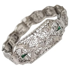 "Art Deco Filigree ""Belly"" Bracelet in 14 Karat Gold with Diamonds and Emeralds"