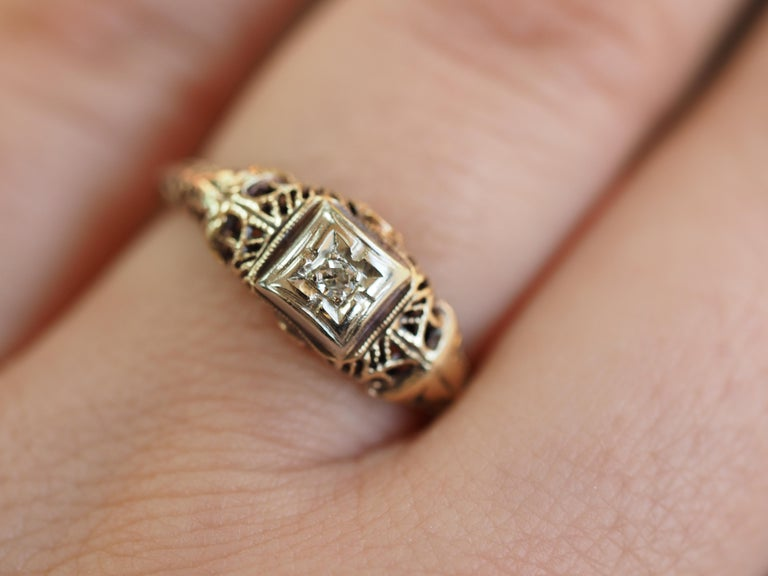 Women's Art Deco Filigree Carved 10 Karat Two-Tone Gold Solitary Diamond Ring For Sale