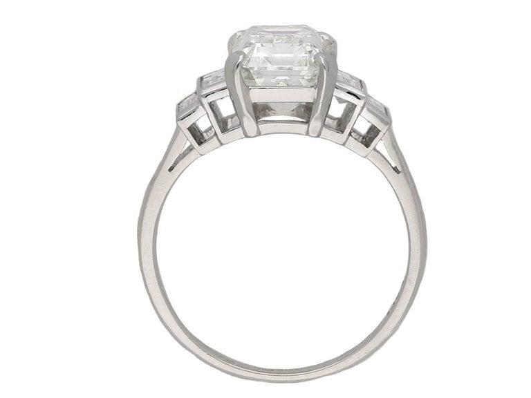 Emerald Cut Art Deco Flanked Solitaire Diamond Ring, Circa 1925 For Sale