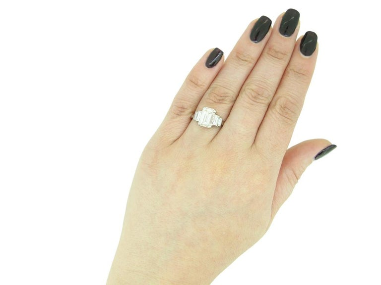 Women's or Men's Art Deco Flanked Solitaire Diamond Ring, Circa 1925 For Sale