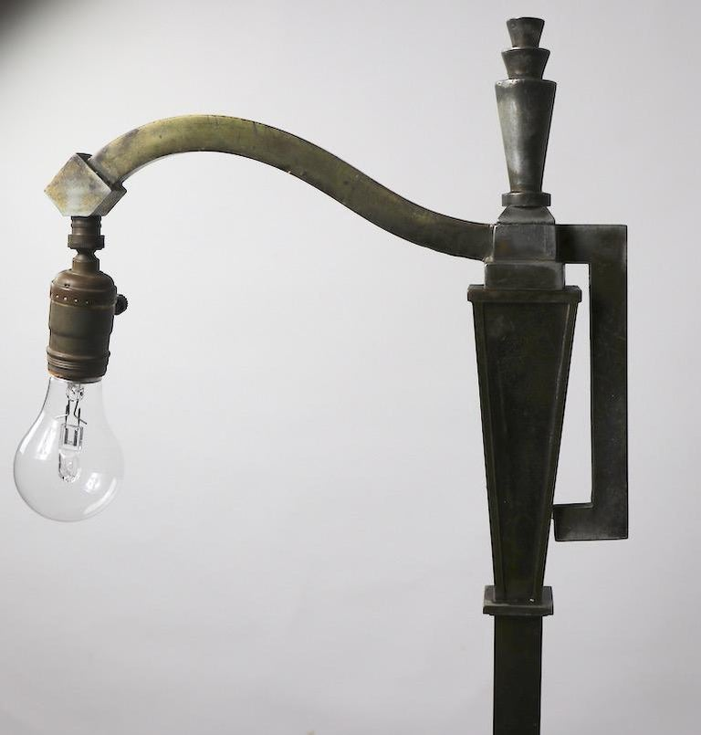 Early Art Deco bridge, floor lamp. This example shows significant wear to the finish, as well as minor splits to the base as shown. Working condition - Accepts standard screw in bulb. Length of arm 12 inches, base 10.25 x 6.