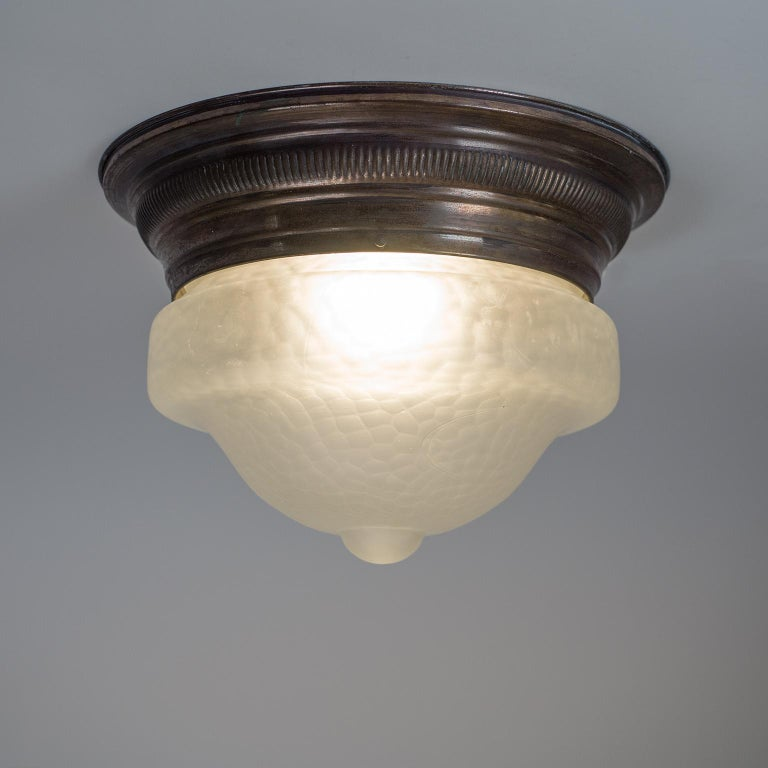 Patinated Art Deco Flush Mount, circa 1920, Brass and Satin Textured Glass For Sale