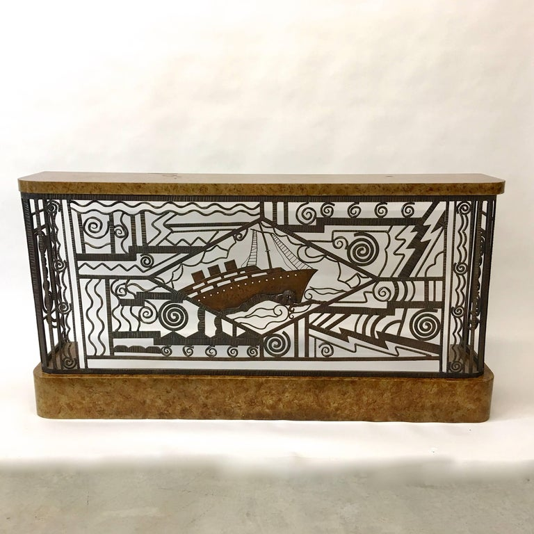 Impressive Art Deco console table or radiator grill cover in hammered patinated wrought iron featuring a three funnel steam ship in central lozenge amidst stylized patterns suggestive of water, nautilus, even lighting. Evocative of certain designs