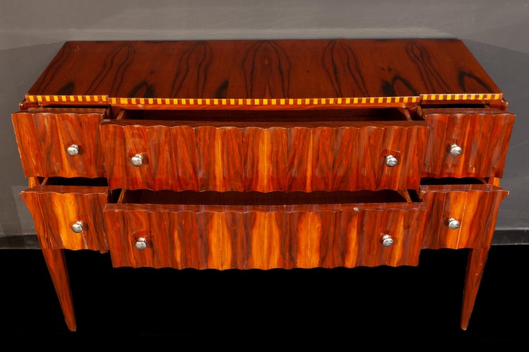 Art Deco dresser with six drawers and brass hardware, inlaid fluted board top. This commode an elegant look offer ample storage space, is in perfect vintage condition.