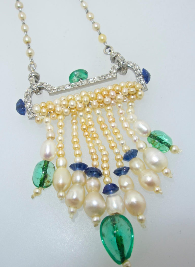French Art Deco  25.5 inches long with French hallmarks on the natural pearl and rose cut diamond chain which suspends the Art Deco pendant which is composed of rose cut diamonds, sapphires and emeralds.  The pendant is 2.5 inches long and can be