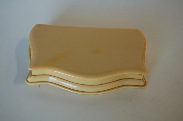 1930s Art Deco French ivory (celluloid) vanity jewelry box mauve velvet lined and scalloped edges.  Measures: 1.5