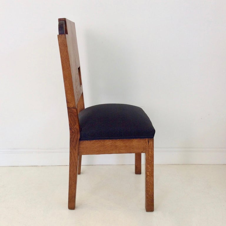 Special Art Deco chair with a nice composition, circa 1930, France. Oak, blackened oak and black fabric. Dimensions: 92 cm H, 45 cm W, 43 cm D, seat height 45 cm. We ship worldwide.