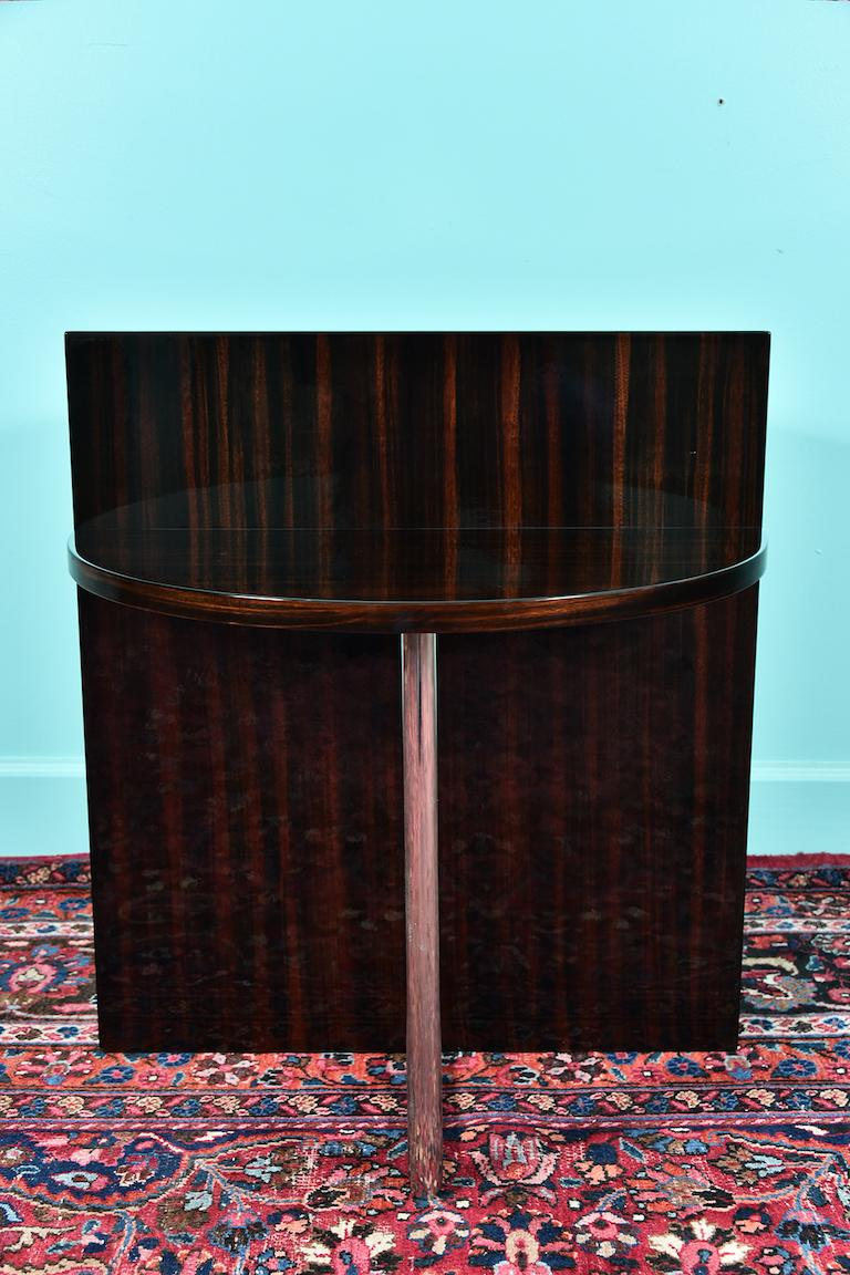 Art Deco French side tables in walnut and chrome  A very unique pair of side tables are composed out of walnut board with double semi-circular table tops, which are connected on the bottom by the chrome tube.  Condition is perfect.   French, circa