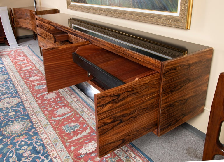 """Art Deco French sideboard in Walnut  Sideboard is made out of beautiful walnut wood. It has several keyless shelves. Sideboard is resting on brass rectangular base.   France, c. 1930s  Measures: 110"""" x 20"""" x 33""""."""
