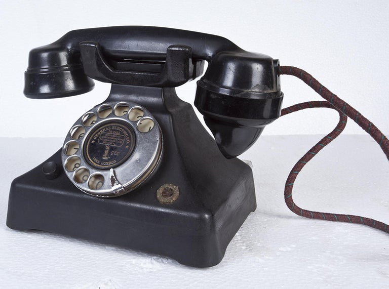 An Art Deco Bakelite telephone by General Electric, London. Chrome rotary dial and refurbished cord. In working order complete with pulse to tone converter. So that you can actually use it.
