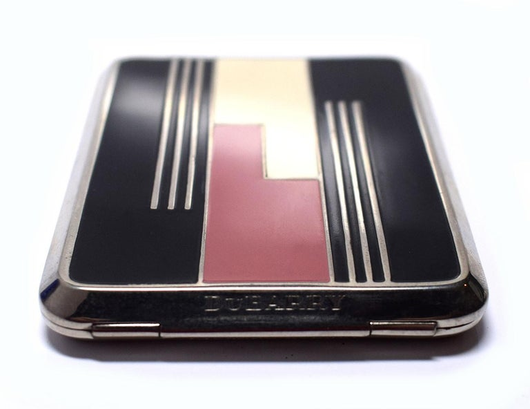 Early 1930's Art Deco Richard Hudnut Du Barry powder compact with remnants of the fine texture face powder in two-tones of bright red. Du Barry scent is still detectable despite the age of the powder. The back of the compact is engine turned with