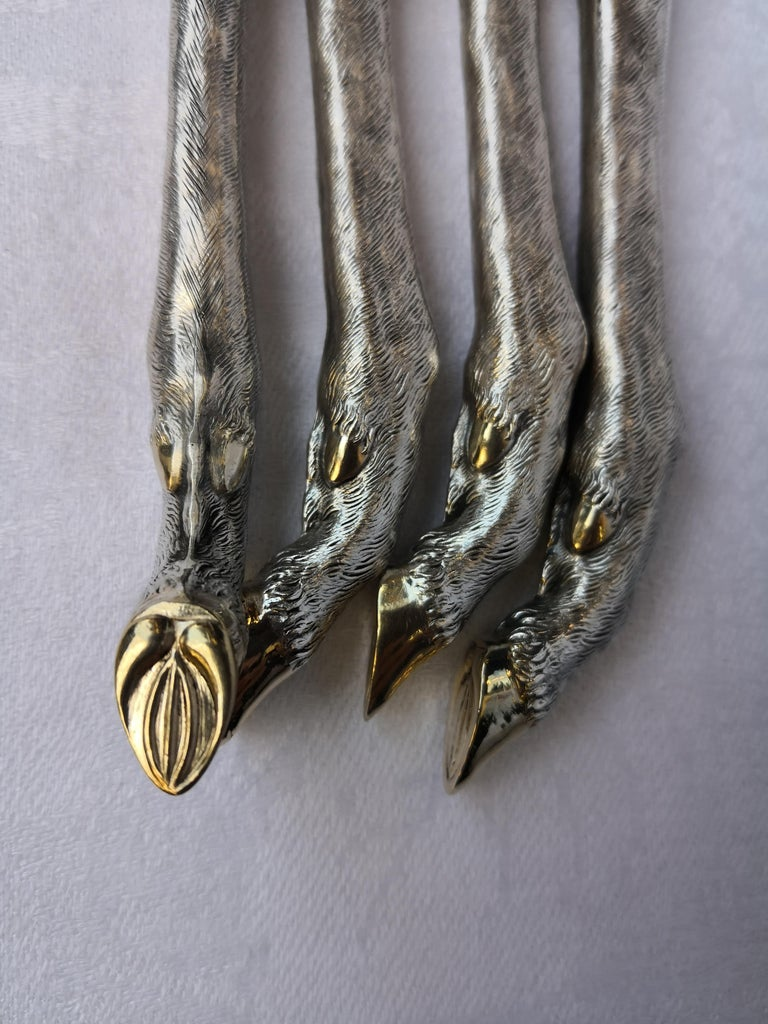 Impressive and fine handmade set of four serving cutlery in 800 silver. The handles are formed as exceptional detailed stag hooves in 800 silver on the end of each piece. The upon parts are stamped steel and gold gilt. Perfect table decoration for