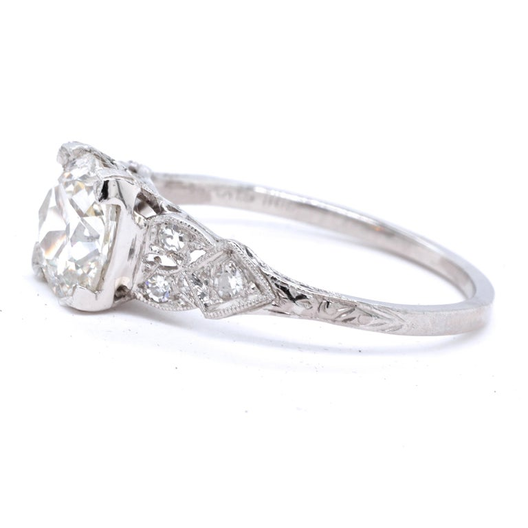 This could be your engagement ring. It has history, charm, elegance and longevity which bodes well for the future. The ring presents symmetry and delicacy, in the best Art Deco traditions. The center stone is GIA certified Old Mine Cut, 1.20 carat,