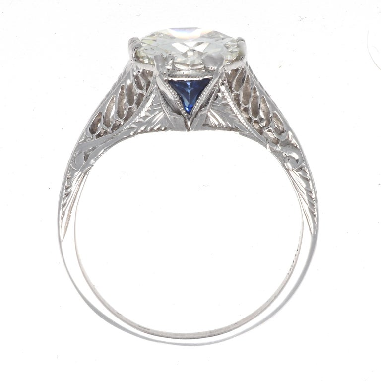 Art Deco platinum ring featuring a GIA 1.86 carat old European cut diamond, graded J color, VS2 clarity. With 2 French cut sapphires. Circa 1920s. Size 6 3/4 and comes with complimentary sizing if needed.  Our 1stdibs Recognized Dealer/Platinum