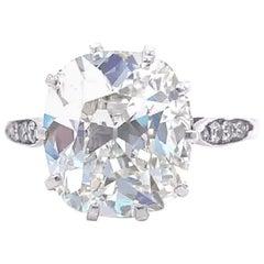 Art Deco GIA 5.02 Carat Antique Cushion Cut Diamond Platinum Engagement Ring