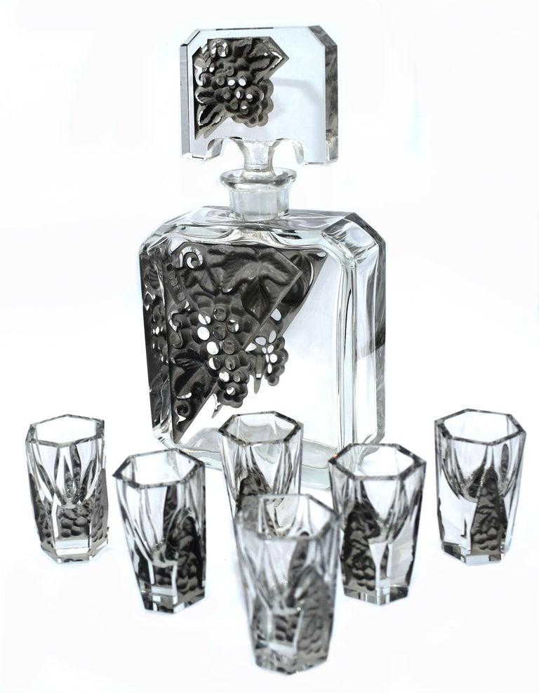 For your consideration is this fabulous Art Deco decanter set with 6 matching glasses, intricately detailed facet-cut glass with acid mat relief panels in a clear glass, manufactured by Curt Schlevogt, who established his own glass company in 1928