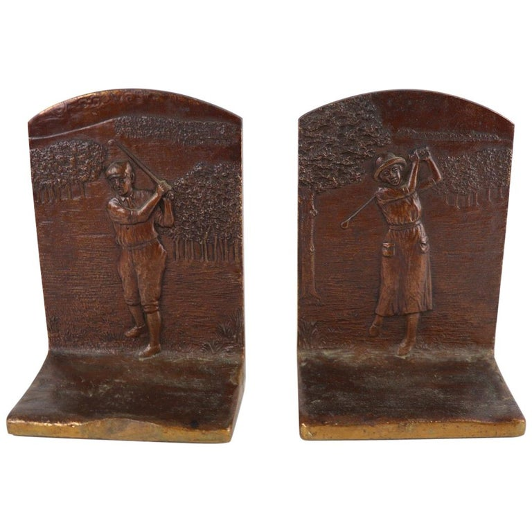 Classic Art Deco bronze attributed to Griffoul depicting a male golfer on one, and a female golfer on the other. Dimensions in listing are per bookend.
