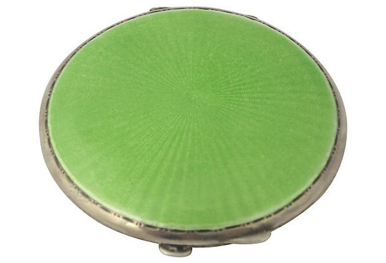 English Art Deco sterling silver compact by Turner & Simpson, 1934. Features a round green engine-turned guilloche enamel sunburst lid with an etched dot and line frame; inside is a round mirror (with yellow age spots) and an area for powder that