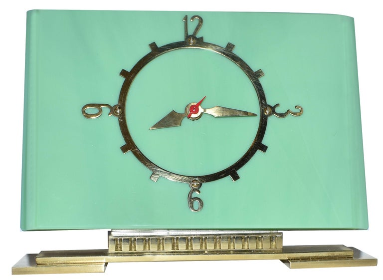 Fabulous 1930s Art Deco modernist mantle clock by British electric meters ltd. Thick vitrolite 'deco green' glass clock with highly polished brass plinth and dial. Runs on electric, works perfectly and has a silent motor so no tics. Lovely condition