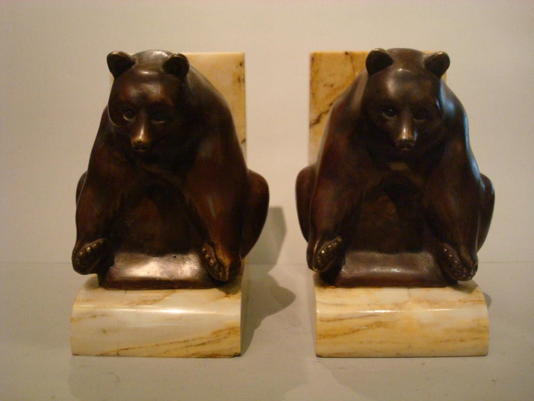 Art Deco Grisby bear bronze bookends, France, circa 1925. Mounted over brown marble base. signed Ch. Soudant, and foundry marks Susse freress ed. Paris. Very Nice sculpture of a playing bear.