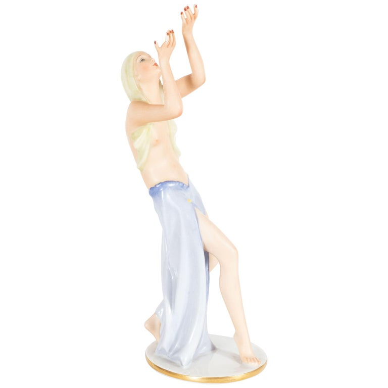 Designed by Gustav Oppel for Rosenthal, circa 1930, this porcelain statuette depicts a semi-clad female dancer with outstretched arms. The figure is hand painted in a naturalistic matte glaze that highlights the subtle detailing and contours of the