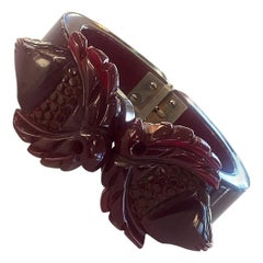 Art Deco Heavily carved dark red bakelite hinged clamper bangle bracelet