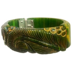 Art Deco heavily carved jade green marbled bakelite clamper hinged bracelet
