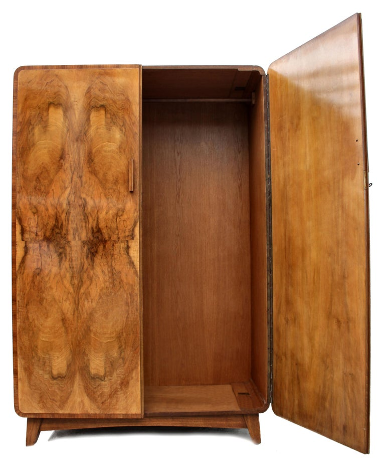 Superbly stylish Continental Art Deco wardrobe with the most glorious bookpage figured walnut veneers. This wardrobe also has a matching tallboy (see other listings). Aside looking very attractive and being functional this wardrobe is also of very