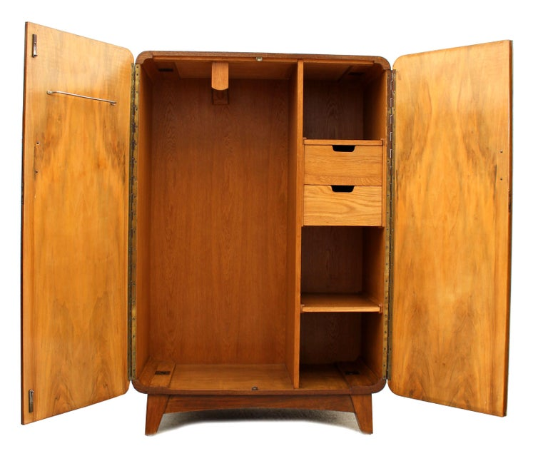 Superbly stylish continental Art Deco tallboy with the most glorious book page figured walnut veneers. This tallboy has a matching wardrobe (see other listings). Aside looking very attractive and being functional this tallboy is also of very good