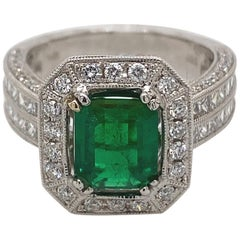 Art Deco Inspired 1.45 Carat Emerald with Diamond Ring 18 Karat White Gold