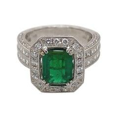 Art Deco Inspired 1.45 Carat Emerald with Diamond Ring 18 Karat White Gold