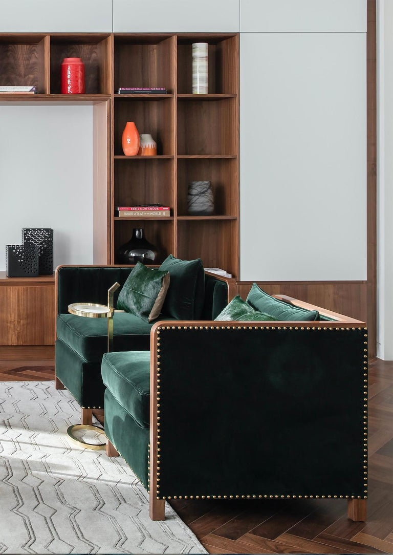 Also inspired by the masculine and desirable qualities of the Roman god, cupid, the Cupid corner armchair combines a fierce, glamorous aesthetic with a luxurious material composition to match. Made from high quality walnut, brass and velvet, the