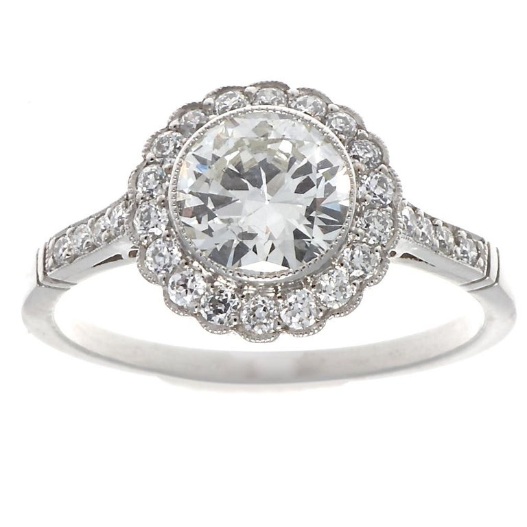 Stunning Art Deco inspired engagement ring. Featuring a 0.90 carat old European cut diamond approximately I color, VVS clarity. Also 26 accenting old European cut diamonds, G-H color, VS clarity. Ring size 7 and comes with complimentary sizing if
