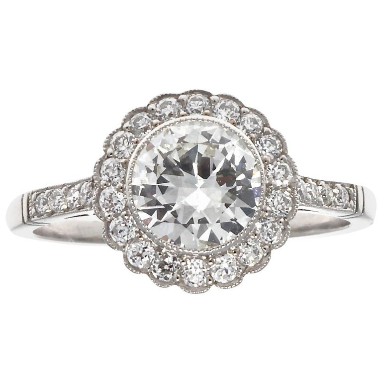 Art Deco Inspired Diamond Platinum Halo Engagement Ring For Sale