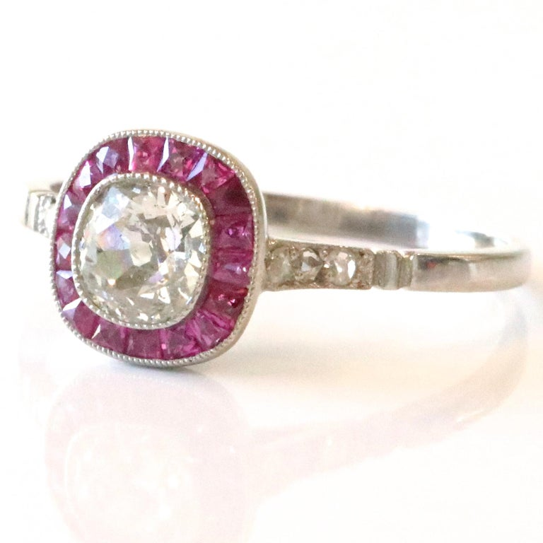 The Art Deco style never gets old! The dancing, the cocktails, the lifestyle, all the things the Roaring 20's are known for. Feel yourself like a 1920's fashionista wearing this gorgeous Art Deco Inspired Diamond Ruby Platinum Ring. The center stone