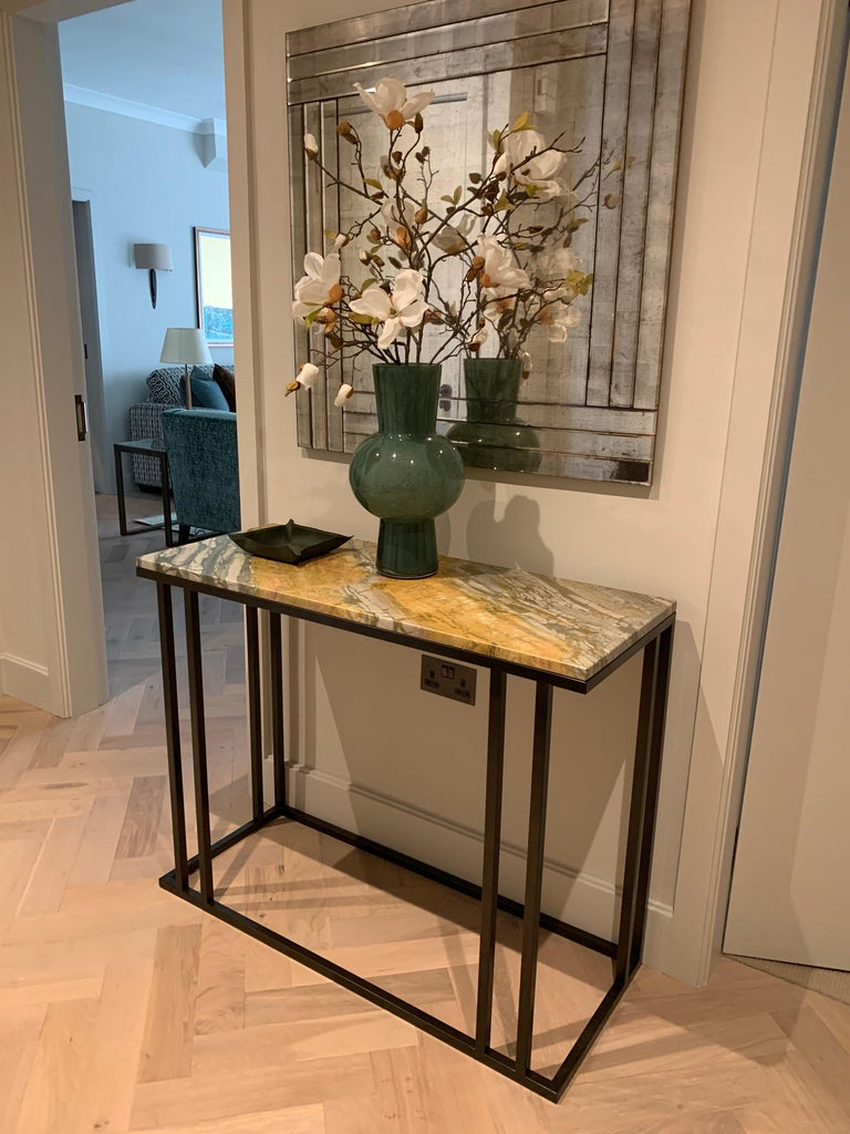 Stainless Steel Art Deco Inspired Elio Console in Antique Brass Tint Structure & Marble Surface For Sale