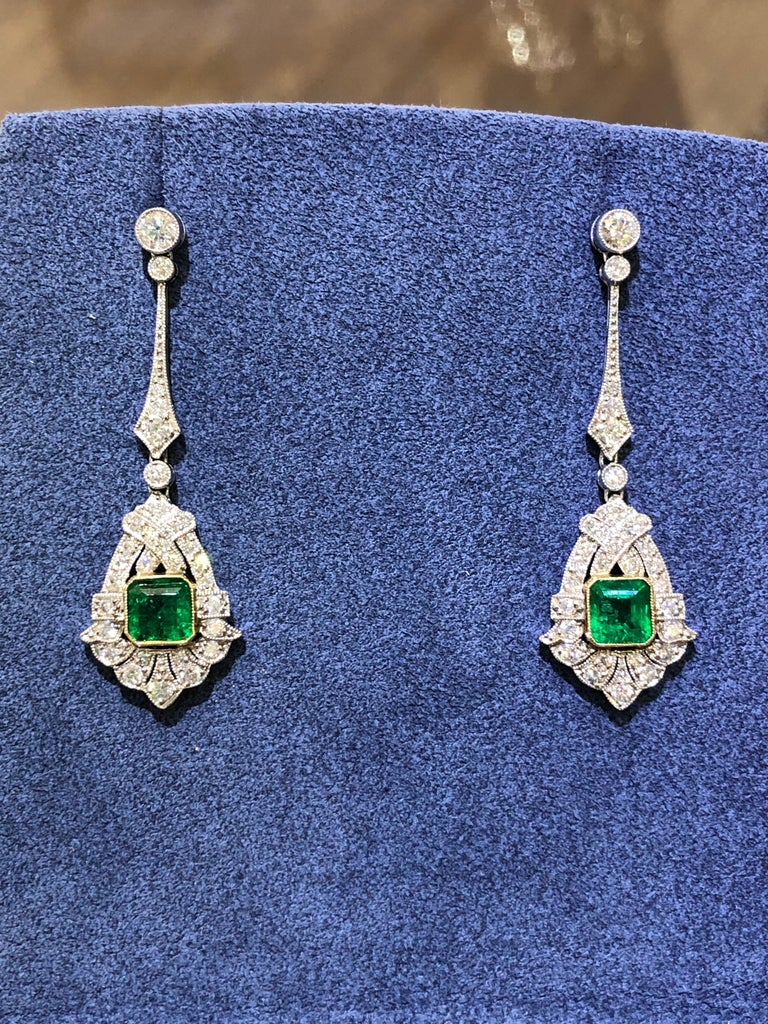 These stunning drop emerald and diamond earrings are One of a kind and handmade. We have made them to resemble Art Deco style earrings.   They are crafted in platinum and 18kt yellow gold, this pair of drop earrings features a succulent 1.60 carat