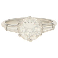 Art Deco Inspired Round and Baguette Cut Diamond Engagement Ring Set in Platinum
