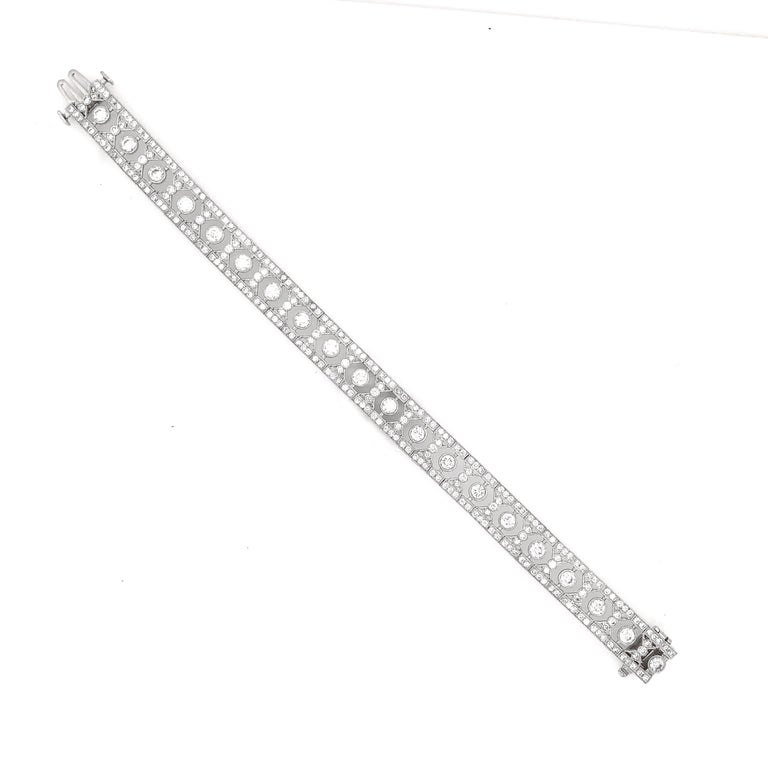 Slim vintage and Art Deco inspired diamond platinum bracelet.  Adorned with white round cut diamonds in 6.12 carat total. Diamonds are all natural in G-H Color Clarity VS.    Platinum 950 bracelet.  Length: 17.5 cm Width. 1 cm Weight: 28.9 g